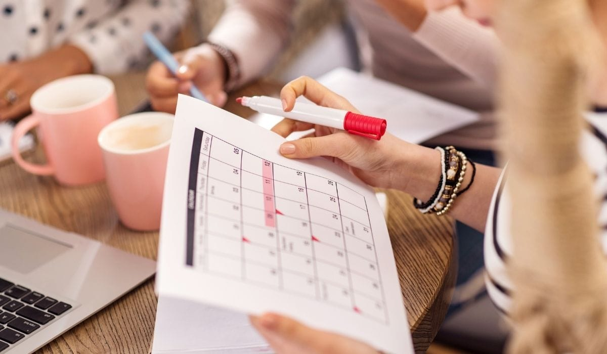a team collaborating meeting schedules