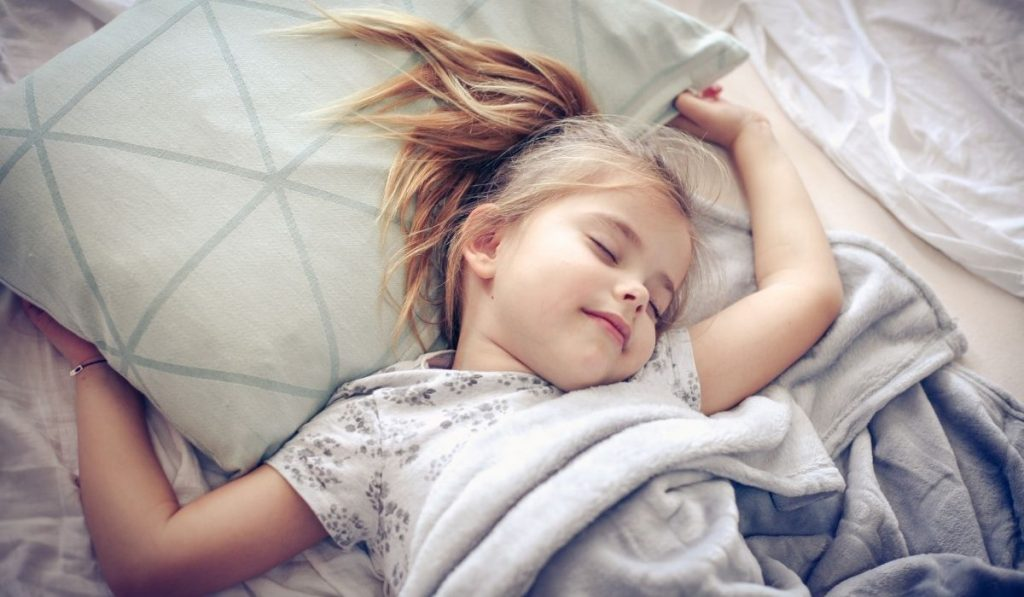 child with sweet dreams while sleeping