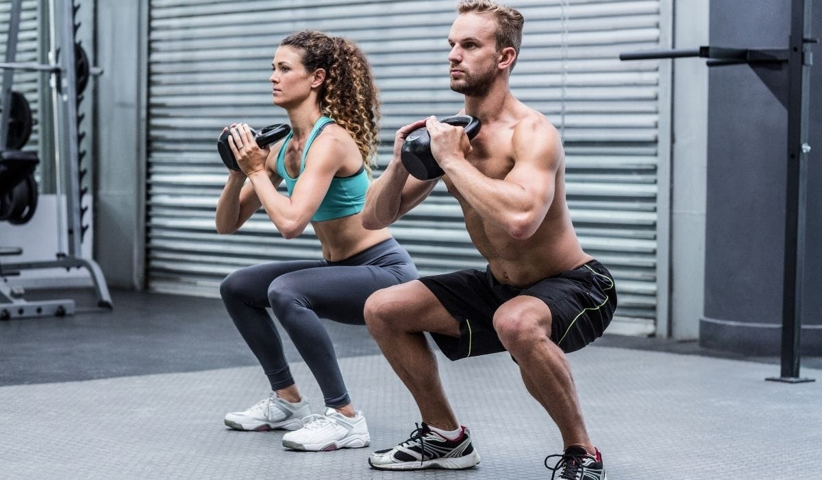 couple exercising with kettlebells