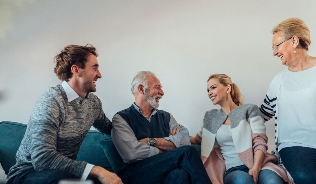 old couple sharing successful stories to younger couple