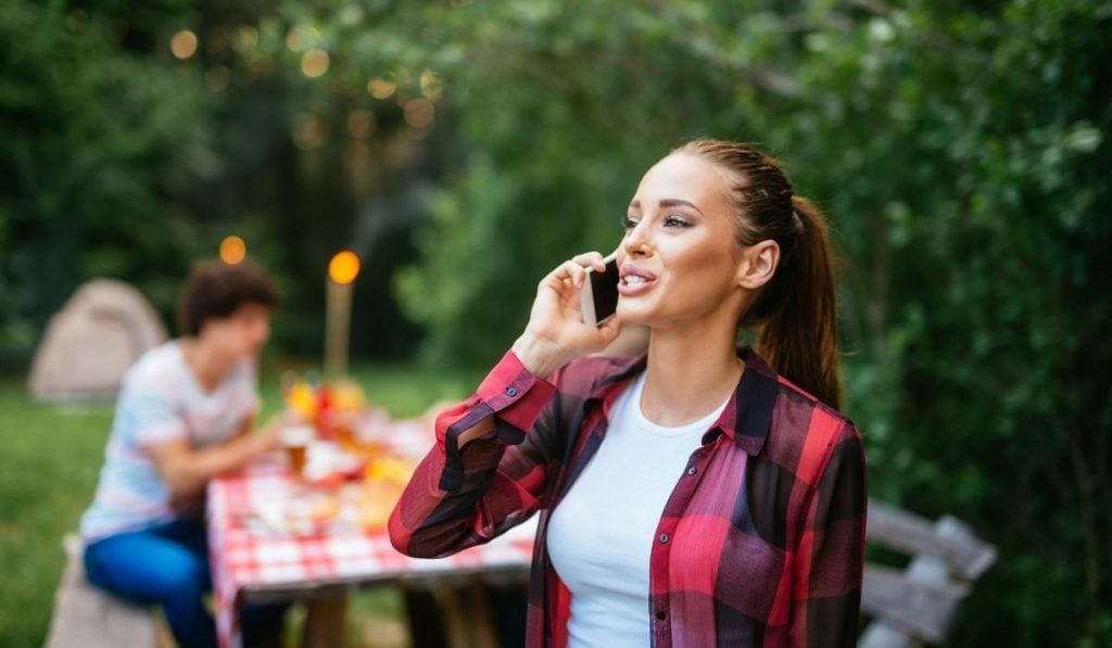 woman talking to her friend on the phone