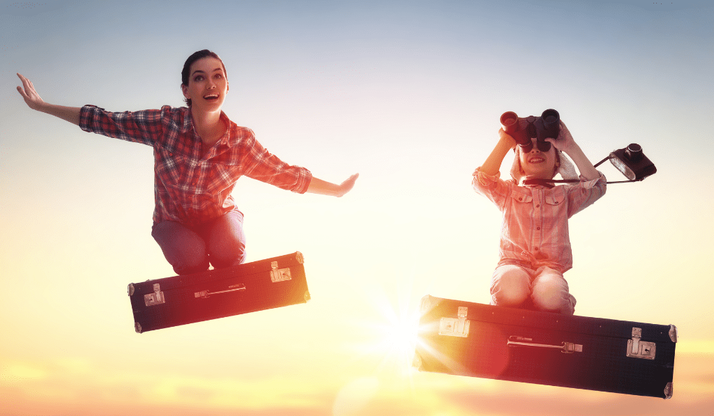 woman and a little girl on a suitcase flying
