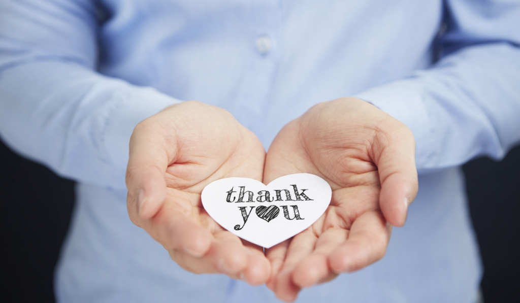thank you note on the girl's hand